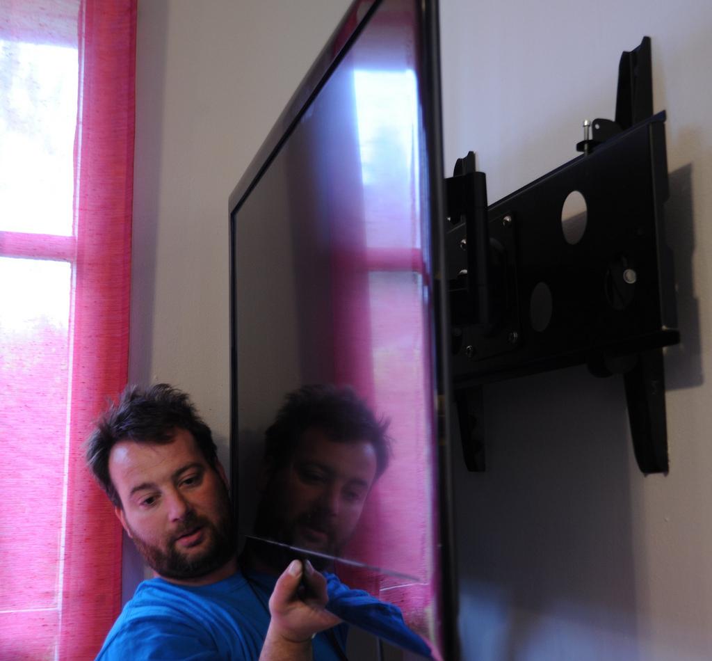 Man mounting a tv